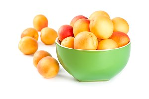 Ripe apricots in ceramic bowl