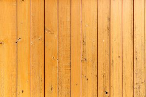 Yellow wood plank fence