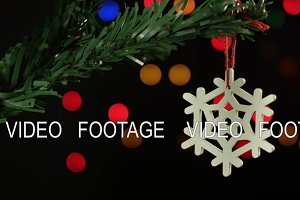 Christmas tree decoration snowflake on the background of sparkling blurred lights