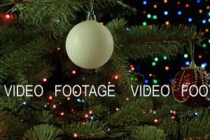 Christmas decoration balls hanging on Christmas tree on the background lights garland fairy