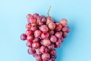 a grape of pink grapes isolated