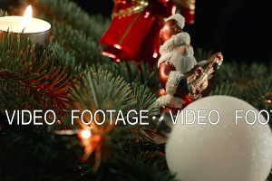 Decorated Christmas tree with Santa on blurred, sparkling and fairy background