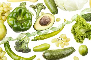 Background from different green fruits and vegetables, isolated