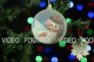 Christmas ornament on a Christmas tree ball on background with blurry lights shinning