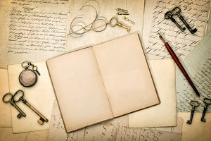 Open diary book and old letters