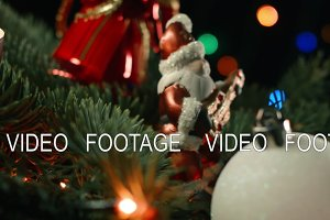Santa with Christmas toys on the background of blurred lights garlands