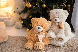 Bears on the background of Christmas tree