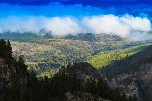 Horizontal vivid cloudscape in high altitude mountains