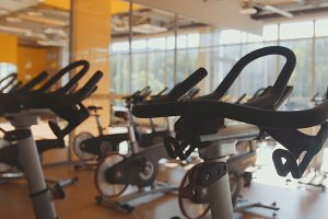 Bicycling simulators in the gym, interior of modern fitness club