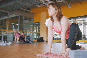 Yoga lesson for women in the gym