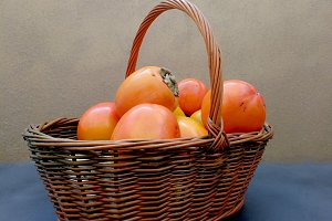 Persimmons on a basket