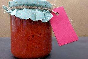 Jam jar with pink label