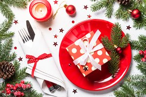 Christmas table setting on white background.