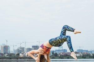 Ccouple practicing yoga outdoors