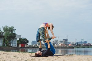 couple practicing yoga outdoors