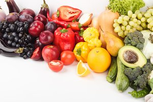 Set of multicolored fresh raw vegetables and fruits, isolated
