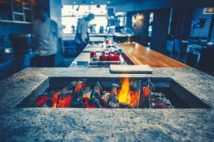 Restaurant kitchen interior: brazier burning wood