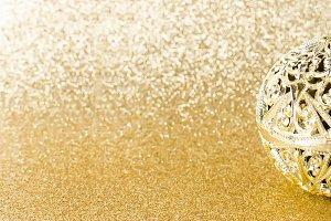 Golden ball on glitter gold texture