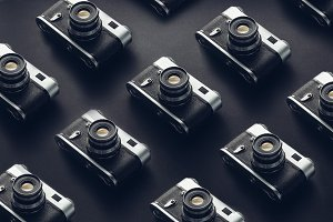 Vintage Film Cameras On Black Background Surface, Isometric View. Creativity Retro Technology Concept