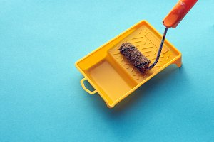 Roller For Paint And Painting Capacy On Blue Background Surface, Isometric View. Home Repair Creativity Concept