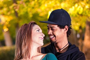 couple in love laughing in the park
