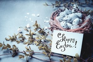 Happy Easter greeting card on blue