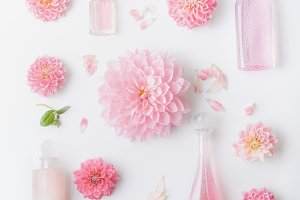 Pastel pink cosmetic and flowers