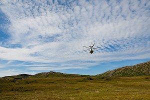 Passenger Helicopter flying in blue sky