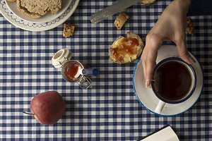 woman having breakfast, his hands an