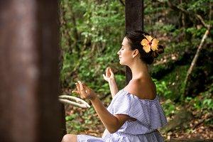 girl in a dress meditates