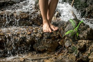 bare female feet on the water
