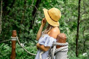 girl standing on the rope bridge