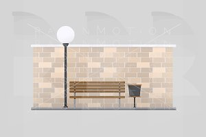 Bench in front of brick Wall