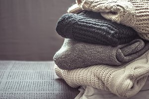 A stack of knitted sweaters