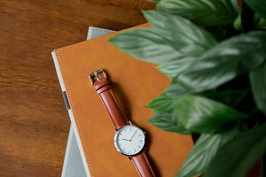 Watch & Notebooks On Desk