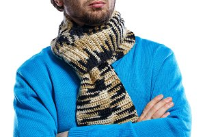 Man wearing scarf and sweater