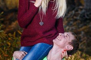Man holding girl on his shoulder