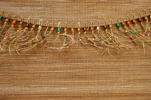 Wooden beads border background