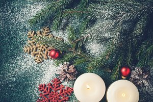 Christmas background with burning candles. Xmas greeting card.