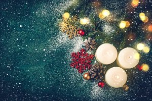 Christmas background with candles and snow. Xmas greeting card