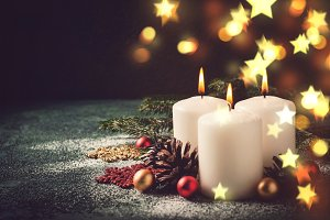 Christmas card with burning candles and decorations