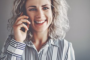 Smiling young female business professional talking on a cellphone