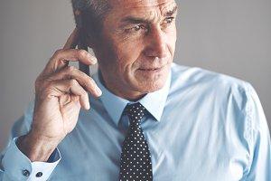 Confident mature businessman having a conversation on a cellphone