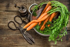 carrots and vintage kitchen utensils