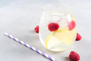 Drink with raspberries and lemon, ice