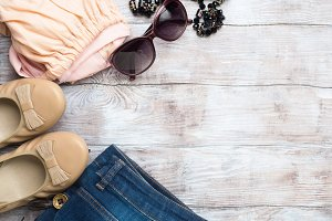 Flat lay with woman's clothes, glasses shoes