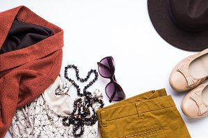 Flat lay with woman's autumn clothes, glasses hat