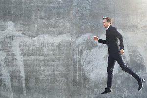 Businessman walking in the air while jumping