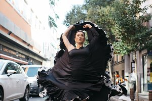 Flamenco dancer practicing outdoors.