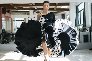 Flamenco dancer practicing indoors.
